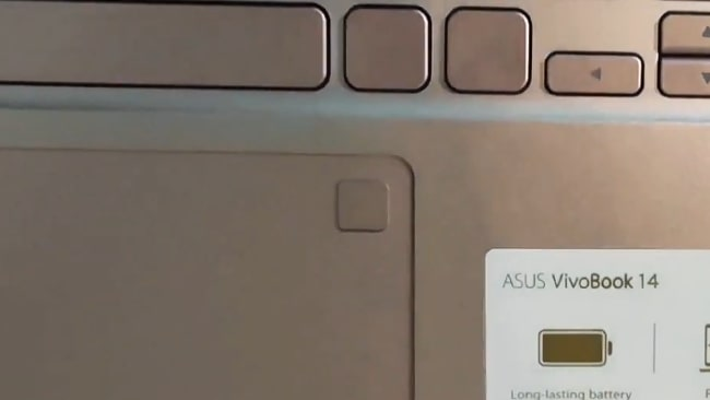 Fingerprint reader in square shape, integrated on the touchpad at the top-right corner.