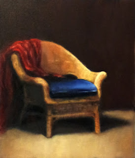 Oil painting of a cane chair with a blue cushion and a red drape.