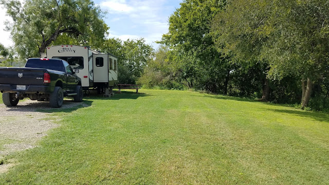 RV in site with shady, large yard