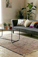 Beige woven rug for living room rugs decorating ideas under glass coffee table with gray sofa