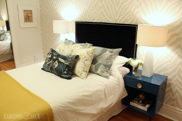 Blue velvet headboard with Etosha wallpaper