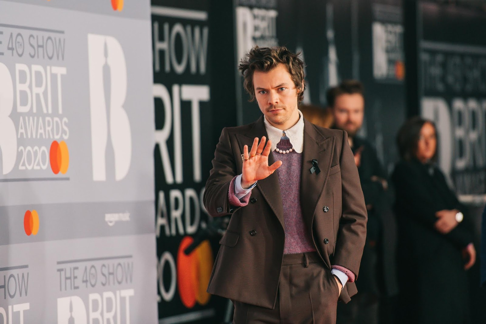 Harry Styles paid tribute to former girlfriend Caroline Flack on Tuesday evening as he arrived at London's O2 Arema for the BRIT Awards