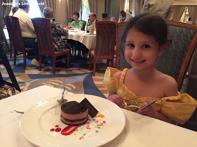 Child with birthday cake on a cruise ship