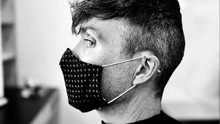 Cillian Murphy wearing a face covering