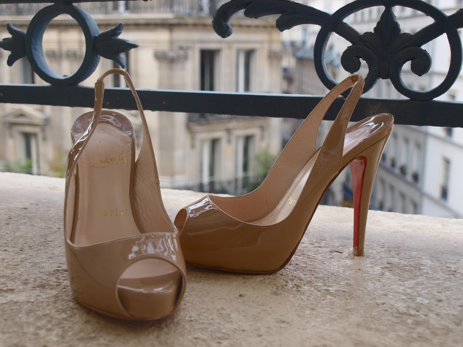 Louboutin pumps on a #Parisapartment balcony by Hello Lovely Studio