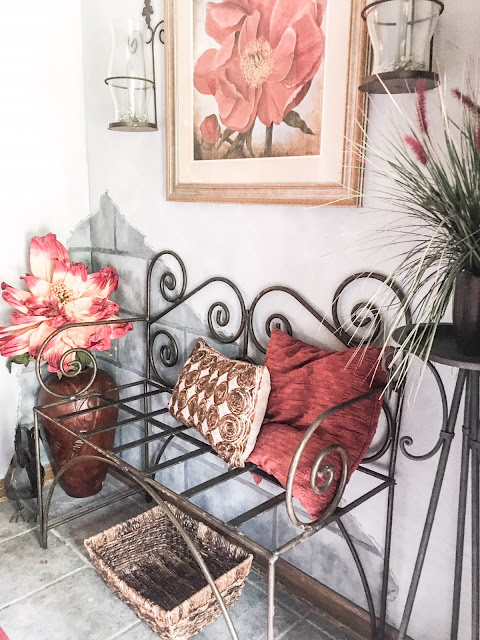 metal bench in entry way