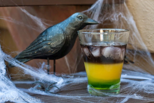 Halloween cocktail, black vodka, midori, melon liqueur, layered cocktail