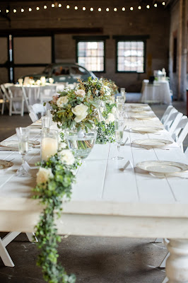 white farm table with greenery