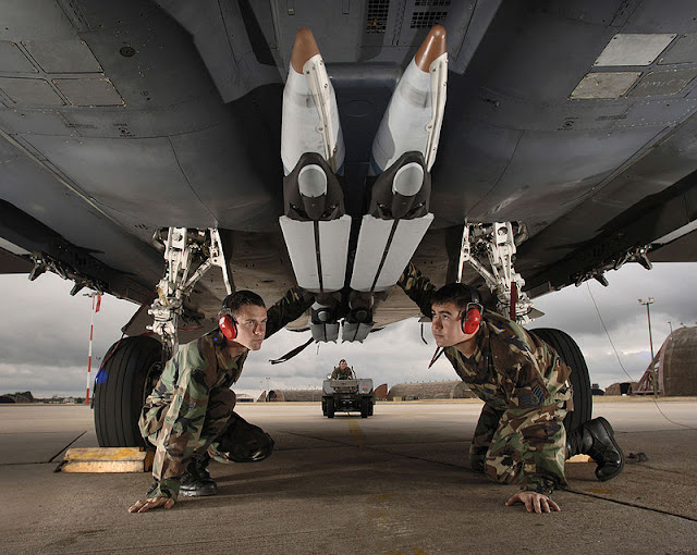 Image Attribute: GBU-39 SDB (Small Diameter Bomb). Airman 1st Class Matt Aggers (left) and Staff Sgt. Randy Broome performs a final check of the stowed twin wings on four ground-training Guided Bomb Unit-39 small-diameter bombs loaded on an F-15E Strike Eagle at Royal Air Force Lakenheath, England, on Aug. 1. / Source: U.S. Air Force photo/Master Sgt. Lance Cheung