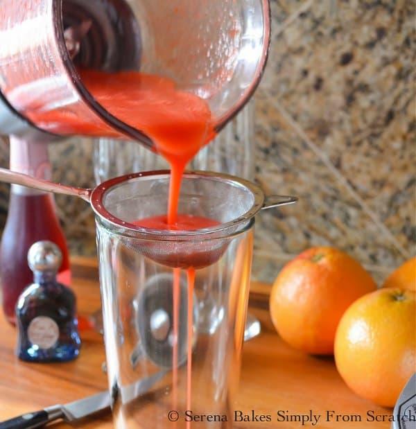 Strain Strawberry Grapefruit Mimosa to remove pulp for Strawberry Grapefruit Mimosas.