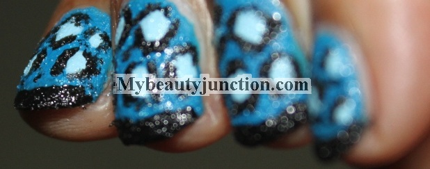 Manicure: Blue textured leopard print nail art with Sally Hansen Sugar Coat nail polish