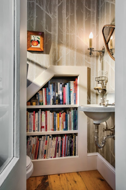 powder room with built in book shelves
