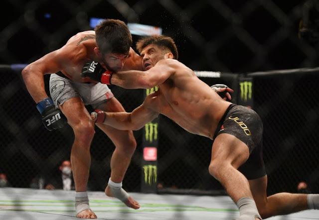 Henry Cejudo wrestles Dominick Cruz UFC 249
