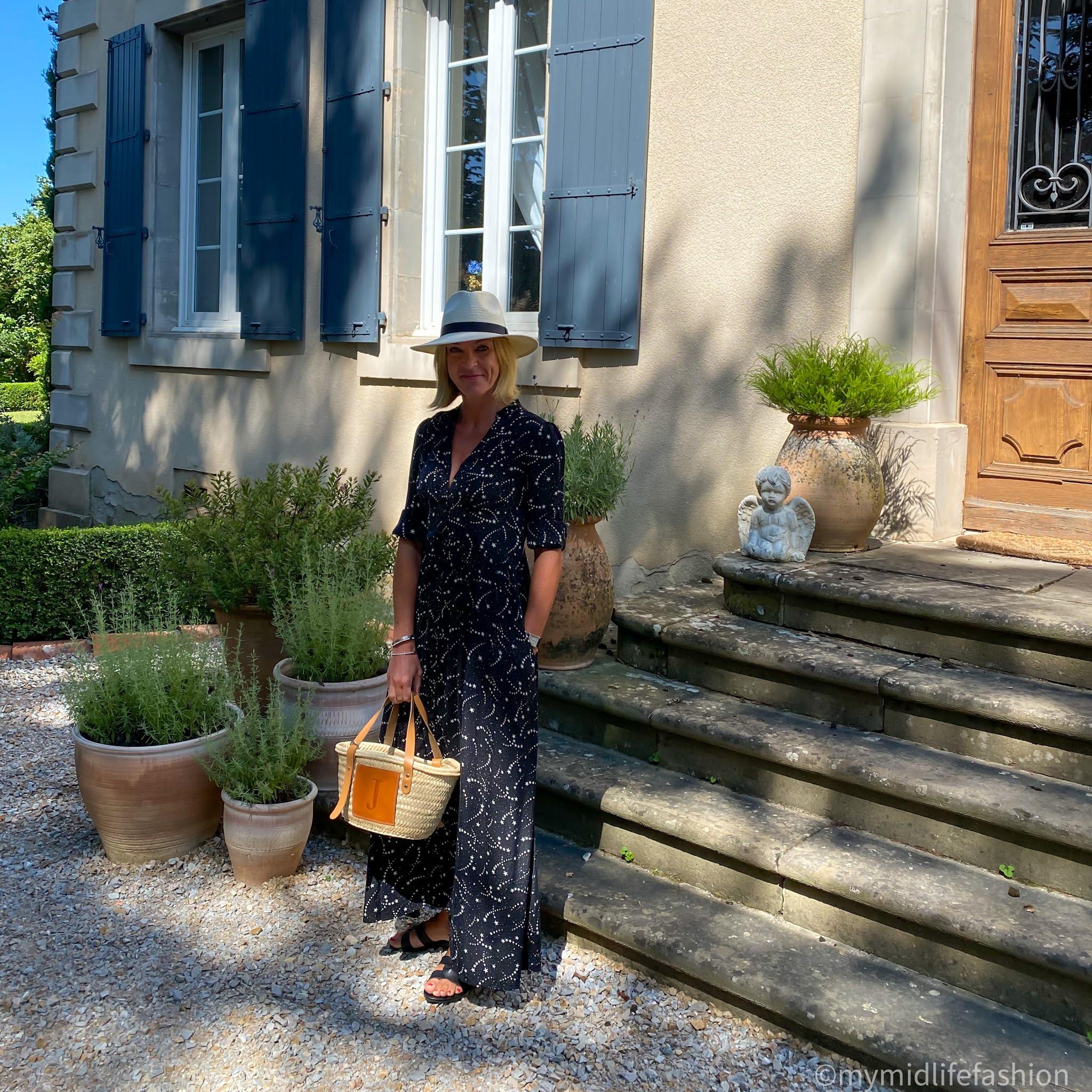 my midlife fashion, saint and Sofia galaxy dress, Zara Panama hat, lada jewellery basket tote, Ancient Greek Desmond leather slides