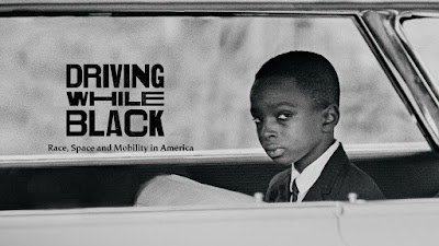 Driving While Black logo on photograph of young black boy in car