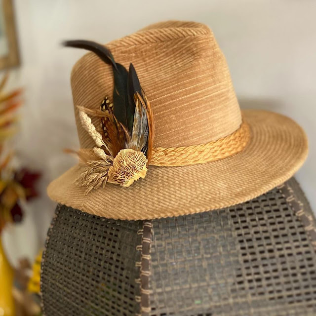 Earthy and beautiful hat pin crafted by Christina Klamer. Image credit Little Lady Impressions.
