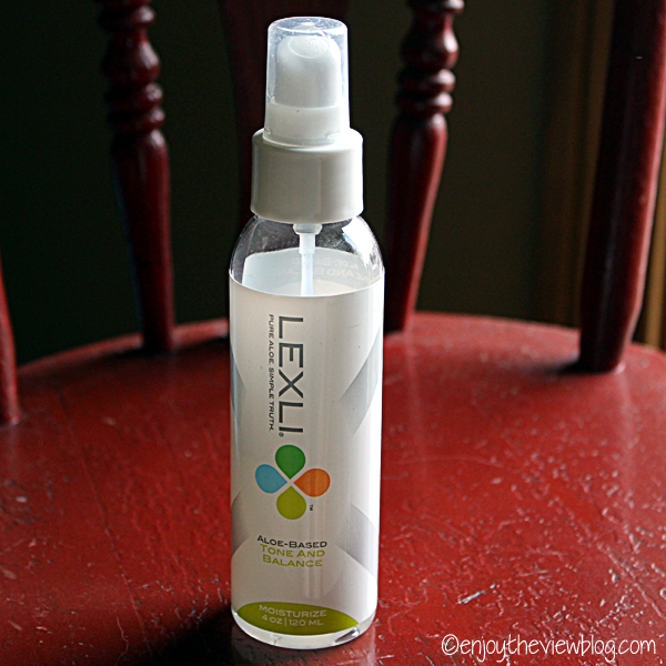 bottle of Lexli aloe-based Tone and Balance Facial Toner sitting on a red chair