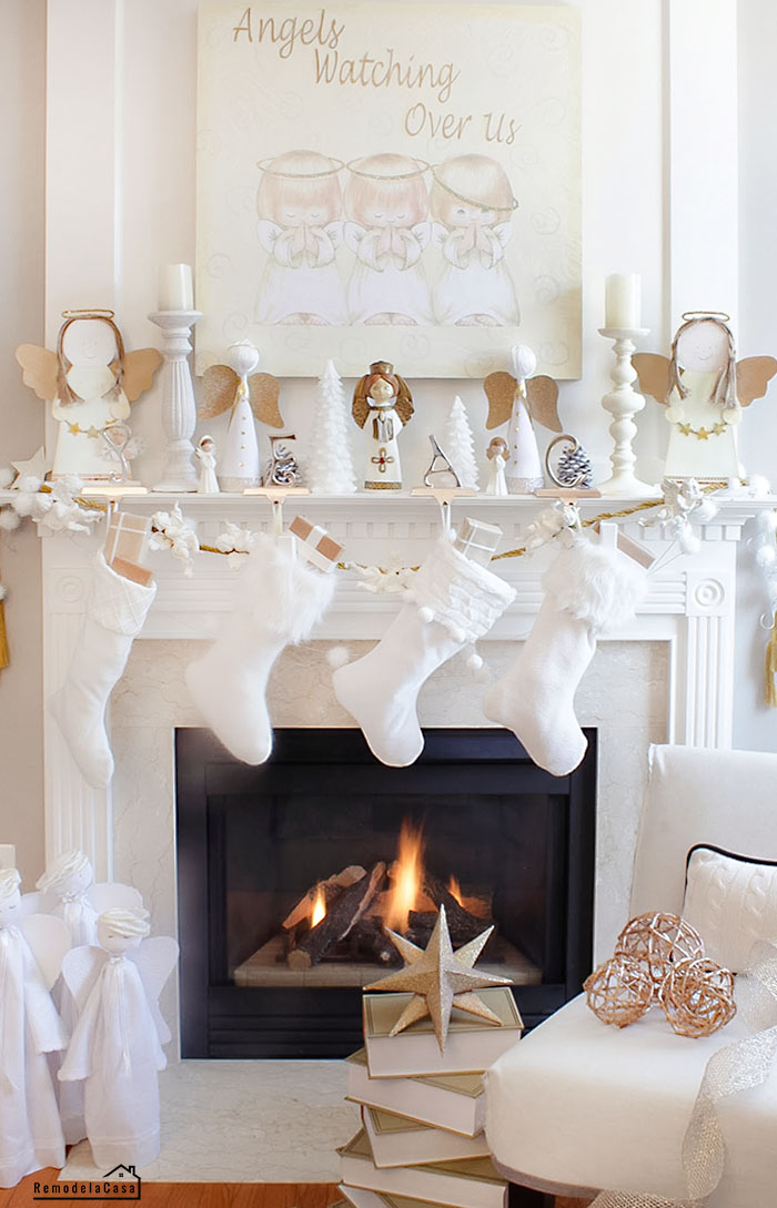 white stockings, angels and more angels, fireplace, wall art