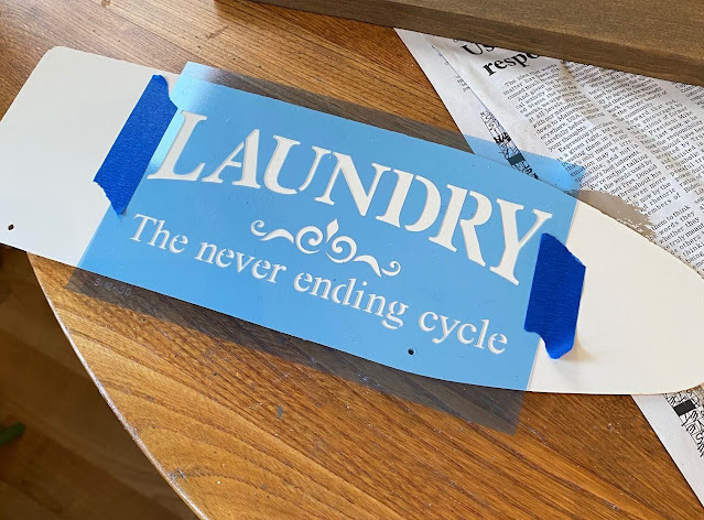 Photo of a laundry stencil on an ironing board shape