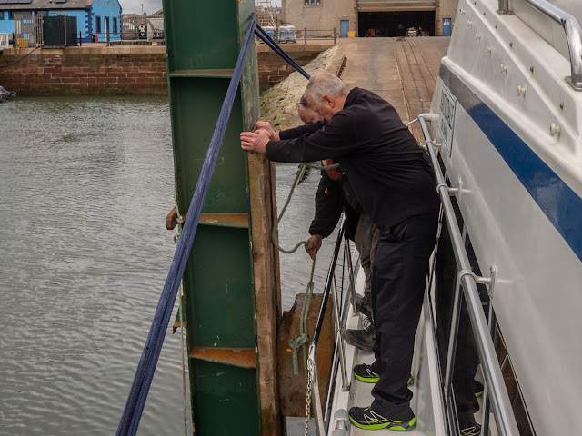 Photo of Phil helping John fix the berthing block because Ravensdale was not as wide as we thought