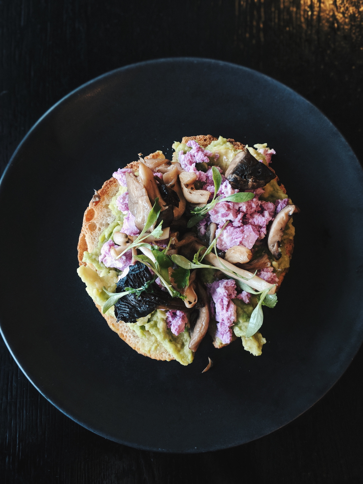 Avocado on toast with crumbled red cabbage feta & wild mushrooms