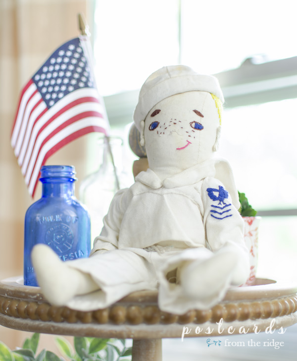 handmade cloth soldier doll on wooden three tier tray