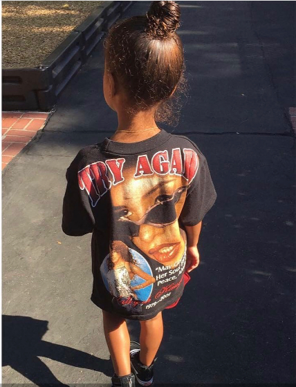 PICTURE OF NORTH WEST WEARING A VINTAGE AALIYAH T-SHIRT WITH TINY VANS THIS WILL MAKE YOU JEALOUS