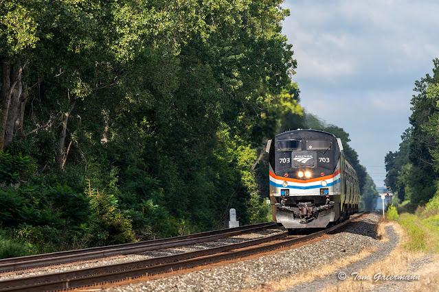 AMTK 703, leading Empire Service train 284, passes the mile 284 marker