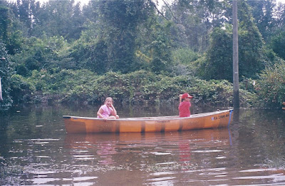 Zack & Sarah canoe in Gaston's flood water in our yard