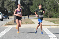 Lindsay Zeiler and Jonathan Grisiaffi turn onto Four Oaks Boulevard about midway through the second annual Tomato Trot 5K.