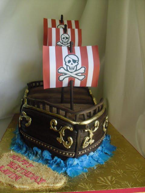 made FRESH daily Pirate Ship Birthday Cake and Cupcakes