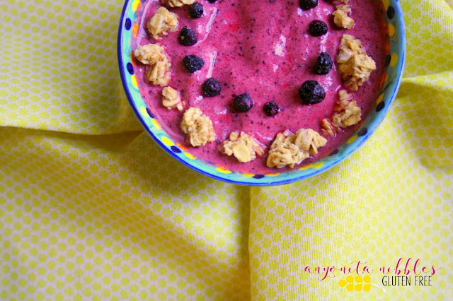 Vibrant smoothie bowl made with Greek yogurt, strawberries, blueberries and gluten free granola from Anyonita-nibbles.co.uk