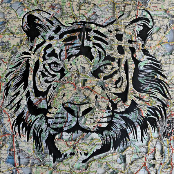 paper cut tiger face composed of layered Michelin maps