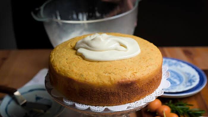 Spread creme fraiche frosting onto cooled down kumquat cake.