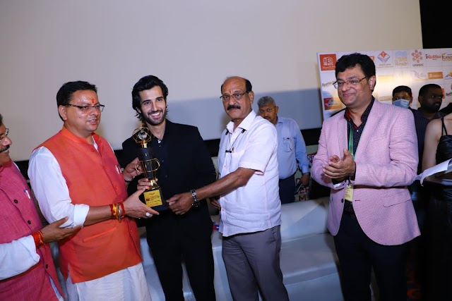 """Aditya Seal receives the """"Most Promising Actor"""" award by the Chief Minister of Uttarakhand at the prestigious 6th  Dehradun International Film Festival"""
