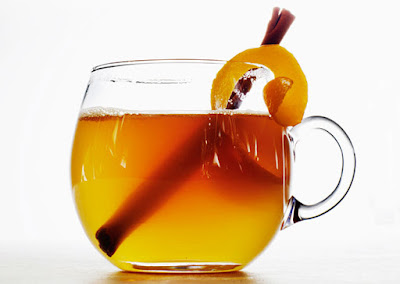 glass with bourbon and honey and lemon mixture with cinnamon stick for garnish called a bourbon hot toddy