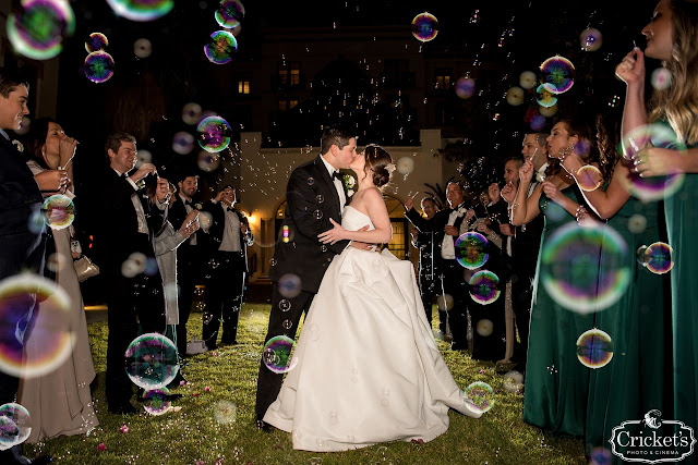bride and groom kissing with bubbles