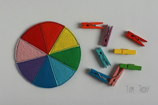 Felt color wheel with wooden clothespins and colorful trinkets