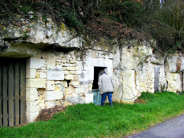 a row of troglodyte dwellings.  Indre et Loire, France. Photographed by Susan Walter. Tour the Loire Valley with a classic car and a private guide.