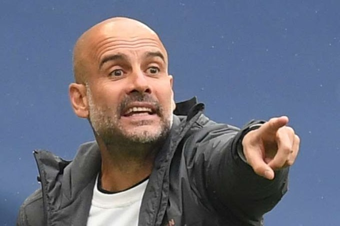 Man City boss Guardiola signs new contract
