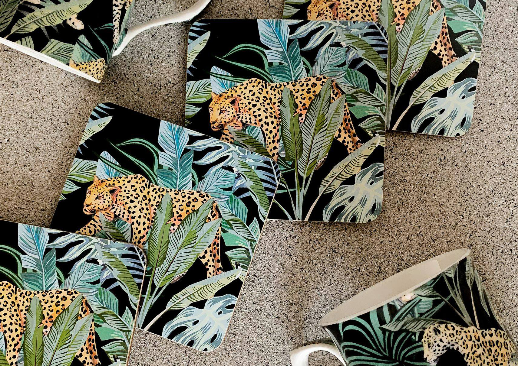Drinks mats with leopards and large plant leaves printed on them.