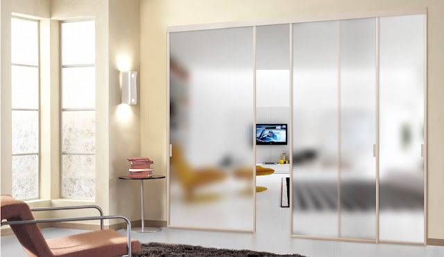 Interior glass partitions with sliding panels