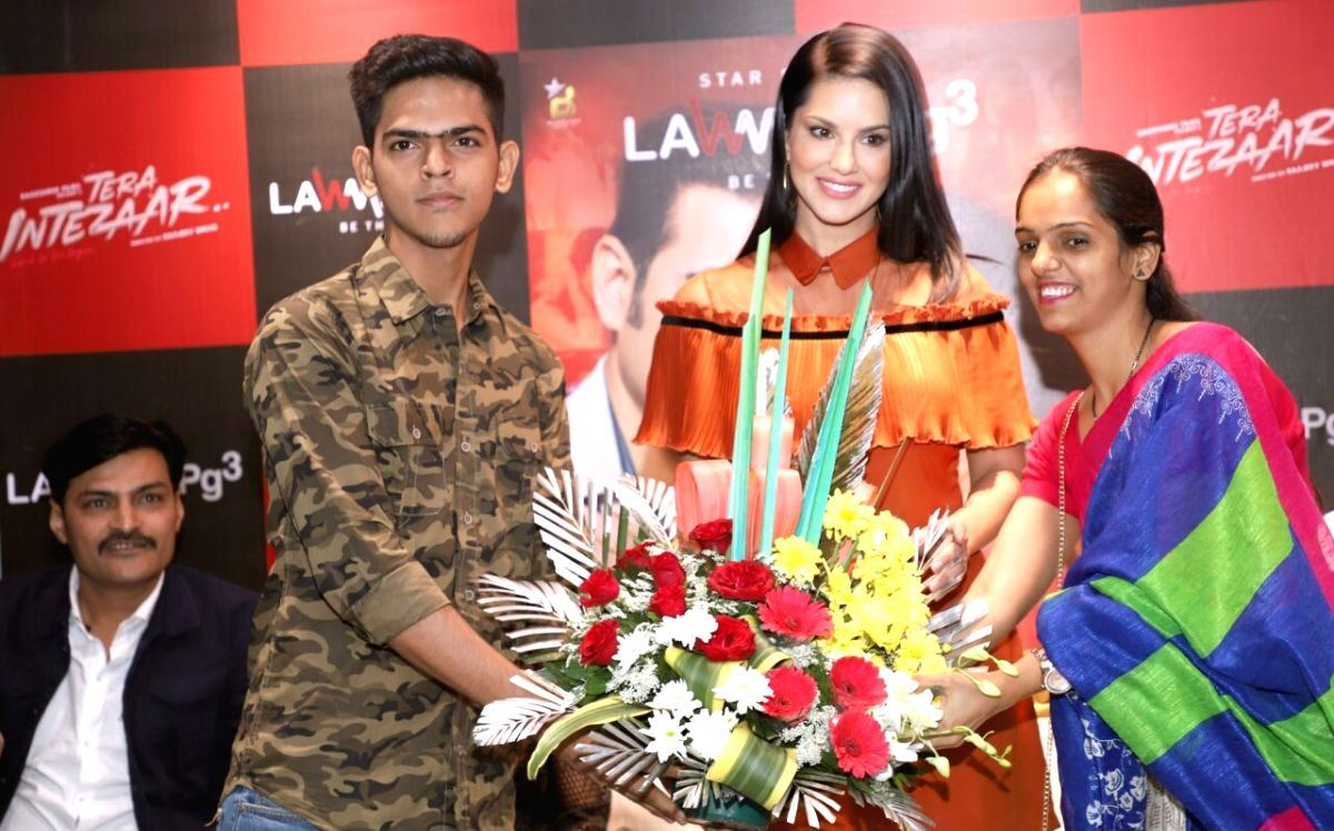Indian Actress Sunny Leone In Orange Dress During a Program Mumbai