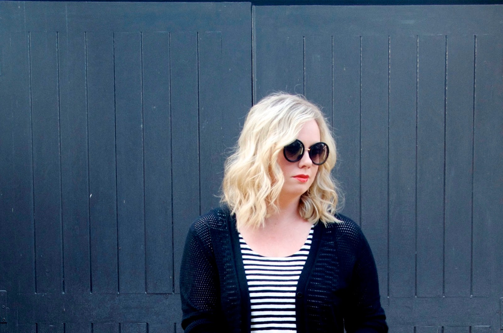 blonde bob, round sunglasses and stripes
