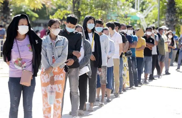 People wait in line to get vaccinated against COVID-19 in Phnom Penh, Cambodia, July 2, 2021. Photo: THX