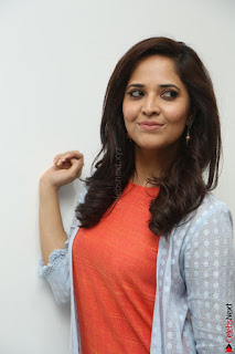 Actress Anasuya Bharadwaj in Orange Short Dress Glam Pics at Winner Movie Press Meet February 2017 (110).JPG