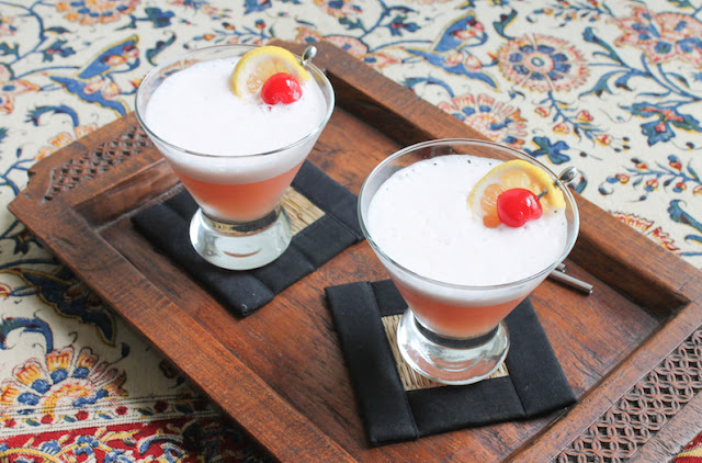 Food Lust People Love: Nicely tart, these Amaretto sour mocktails are made with pineapple, maraschino cherry and lemon juice. They are deliciously refreshing on a hot summer day.