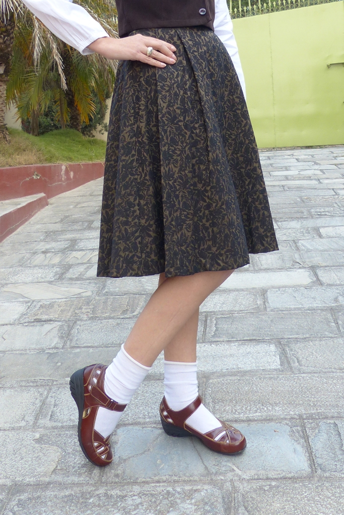 Brown skirt, white socks with flat shoes