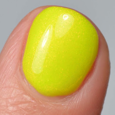 neon yellow nail polish with shimmer swatch