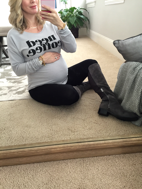 Winter fashion | Need Coffee sweatshirt & knee high boots with leggings - cute, casual pregnancy outfit #maternitystyle #dressingthebump